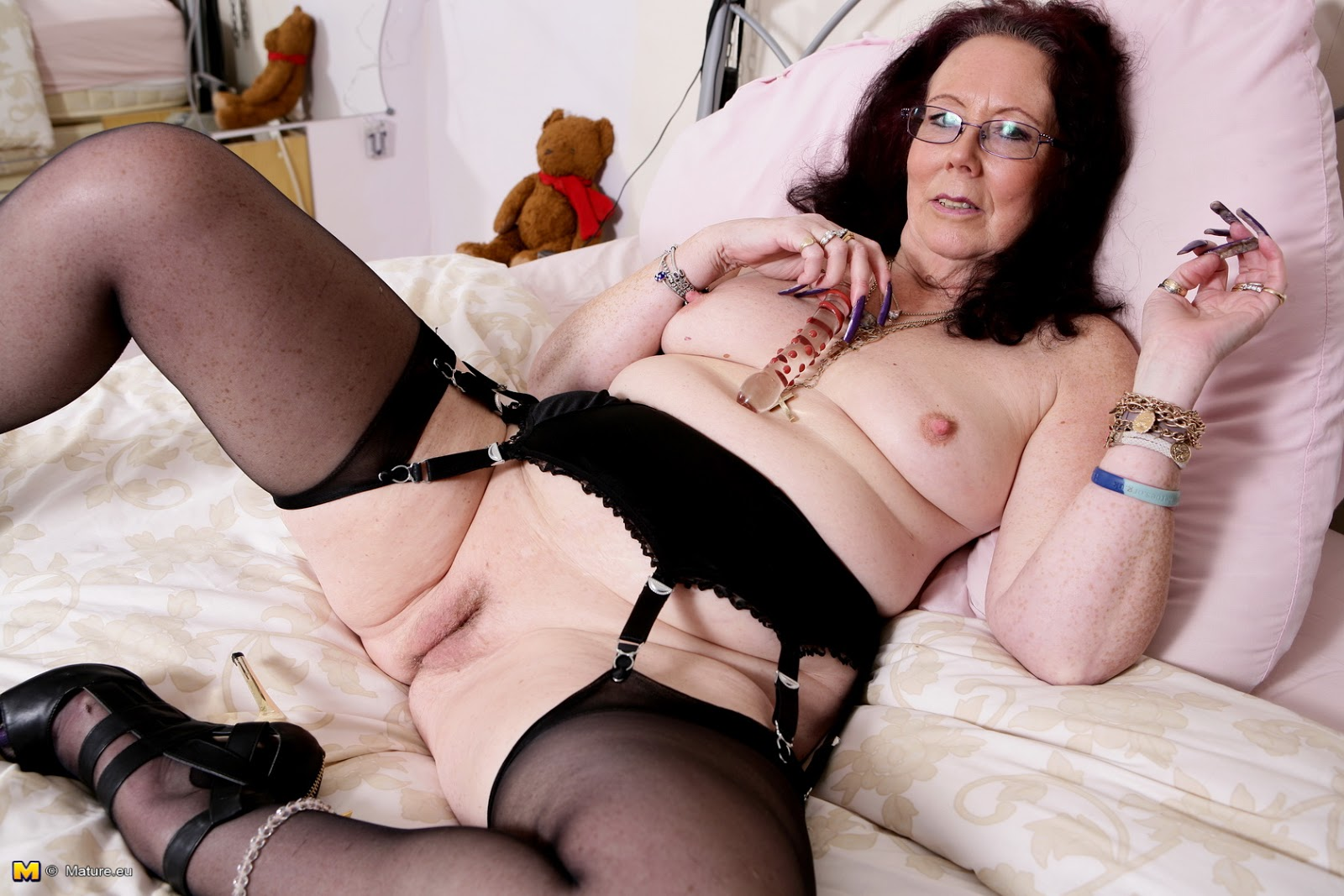 Sexy mature woman relaxing